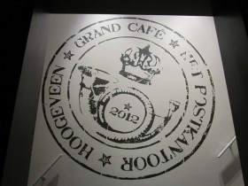 muurschildering logo